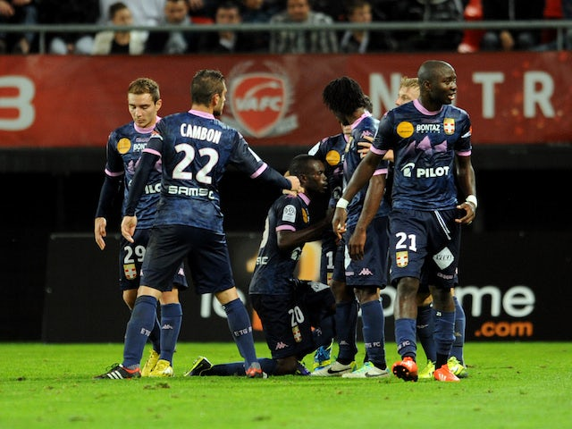 Evian's Moudou Sougou celebrates with teammates after scoring a goal during the French L1 football match Valenciennes vs Evian TG at the Stade Du Hainaut in Valenciennes on October 26, 2013