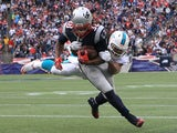 Brandon Bolden #38 of the New England Patriots scores as Philip Wheeler #52 of the Miami Dolphins attempts to defend in the second half at Gillette Stadium on October 27, 2013