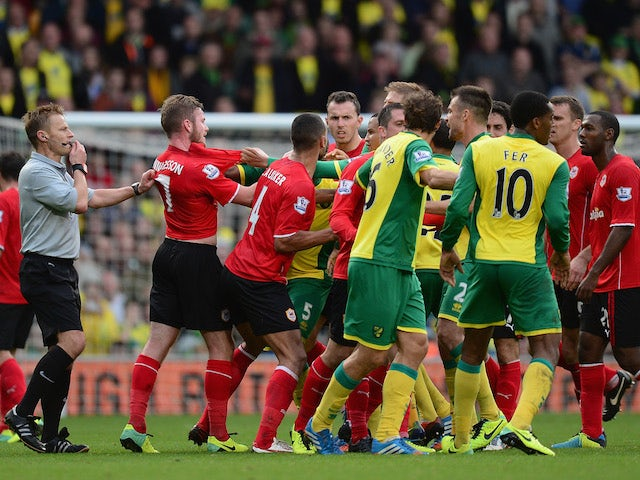 Tempers flare between the two sides during the Barclays Premier League match between Norwich City and Cardiff City at Carrow Road on October 26, 2013