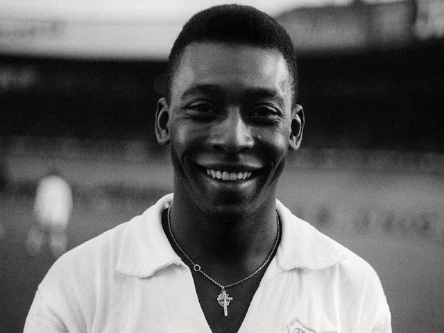 Pele, when playing for Santos, smiles at the camera ahead of a friendly match on June 13, 1965