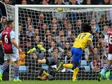 Everton's Belgian striker Romelu Lukaku scores the opening goal past Aston Villa's Brad Guzan during the English Premier League football match on October 26, 2013