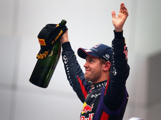 Sebastian Vettel of Germany and Red Bull celebrates winning the Indian Grand Prix and his fourth consecutive world title on October 27, 2013