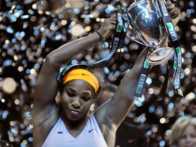 Serena Williams of the US celebrates with her trophy after winning the WTA Championships final tennis match against China's Li Na on October 27, 2013