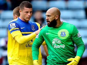 Goalkeeper Tim Howard of Everton is congratulated by team mate Ross Barkley after saving a penalty during the Barclays Premier League match against Aston Villa on October 26, 2013