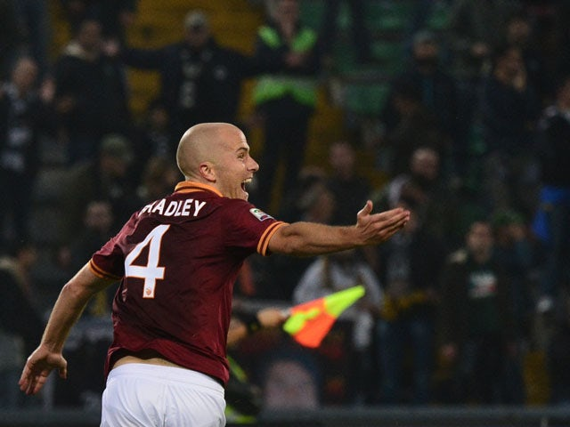 AS Roma's US midfielder Michael Bradley celebrates after scoring during the Serie A football match Udinese vs AS Roma at 'Stadio Friuli' in Udine on October 27, 2013