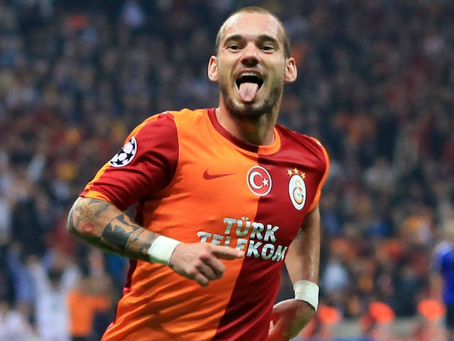 Galatasaray's Dutch midfielder Wesley Sneijder celebrates scoring a goal during the UEFA Champions League Group B football match between Galatasaray and FC Copenhagen on October 23, 2013
