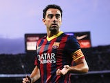 Xavi prepares to take a corner for Barcelona against Sevilla on September 14, 2013.