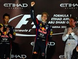 Red Bull Racing's drivers German Sebastian Vettel and Australian Mark Webber and Mercedes' German driver Niko Rosberg poses after winning the Abu Dhabi Formula One Grand Prix on November 3, 2013