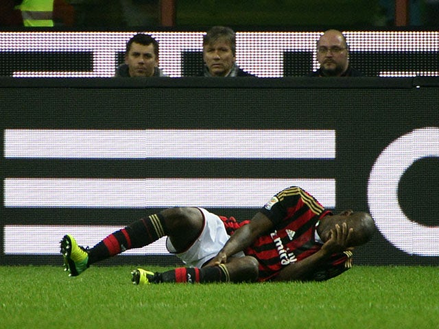 AC Milan's forward Mario Balotelli falls down before leaving the pitch on an injury during the Italian serie A football match AC Milan vs Fiorentina, on November 2, 2013