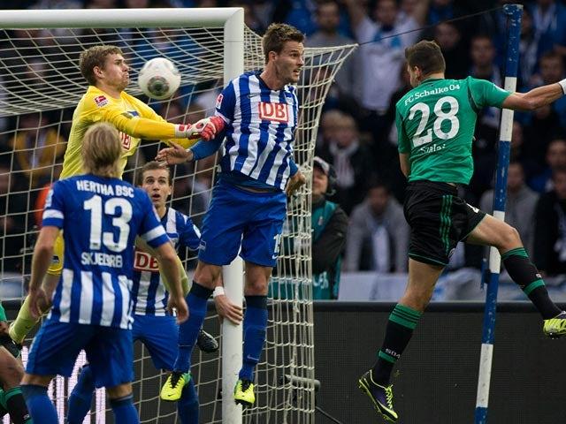Schalke's Adam Szalai heads in the opening goal against Hertha on November 2, 2013