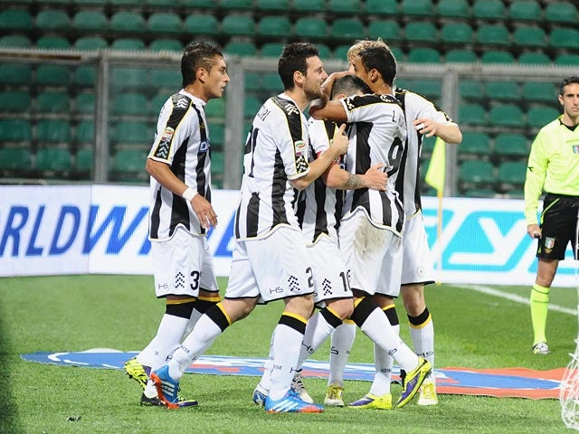 Udinese's Antonio Di Nataleis congratulated by team mates after scoring the opening goal via the penalty spot against US Sassuolo Calcio on October 30, 2013