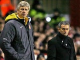 Arsenal's manager Arsene Wenger and his Chelsea counterpart Jose Mourinho watch their teams during their premiership match at Highbury in north London, 18 December 2005