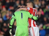 Asmir Begovic of Stoke City is congratulated by team-mate Ryan Shawcross after scoring the opening goal during the Barclays Premier League match between Stoke City and Southampton on November 02, 2013