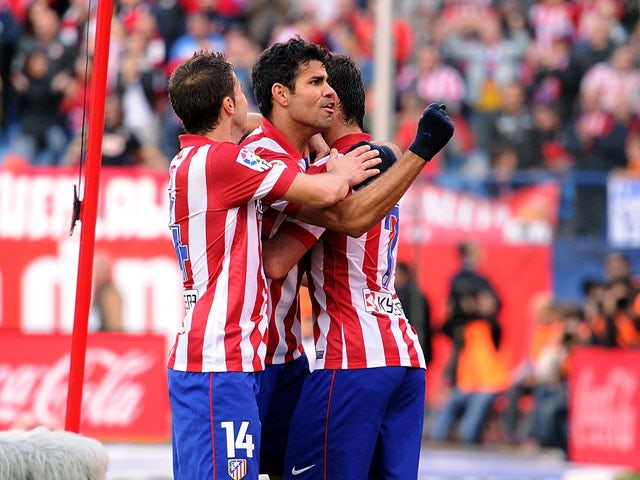 Diego Costa of Club Atletico de Madrid celebrates after scoring his team's 2nd goal during the La Liga match between Club Atletico de Madrid and Athletic Club at Vicente Calderon stadium on November 3, 2013