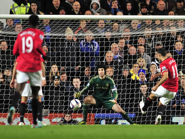 Manchester United's Welsh midfielder Ryan Giggs shoots to score the opening goal as Chelsea's Czech goalkeeper Petr Cech looks on during the English League Cup Fourth Round football match between Chelsea and Manchester United at Stamford Bridge in London,