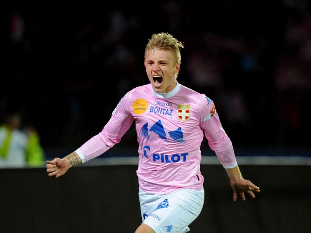Evian's Danish defender Daniel Wass jubilates after scoring a goal during the French L1 football match Evian (ETGFC) vs Toulouse (FC) on November 2, 2013