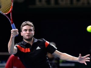 Gilles Simon in action against Nicolas Mahut during round two of the Paris Masters on October 30, 2013