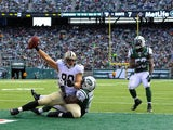 Tight end Jimmy Graham of the New Orleans Saints makes a touchdown catch in the 2nd quarter against the New York Jets at MetLife Stadium on November 3, 2013