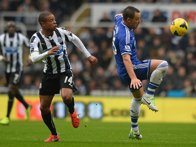 Chelsea's John Terry and Newcastle's Loic Remy battle for the ball on November 2, 2013