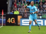 Marseille's Jordan Ayew celebrates moments after scoring the eqauliser against Rennes on November 2, 2013