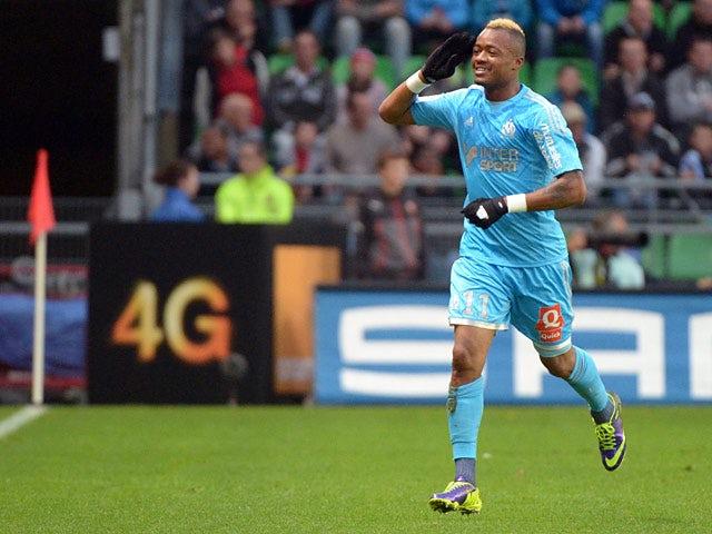 Marseille's Jordan Ayew celebrates moments after scoring the eqauliser against Rennes on November 2, 2013