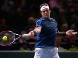 Juan Martin Del Potro in action against Marin Cilic during round two of the Paris Masters on October 30, 2013