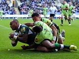Sailosi Tagicakibau of London Irish gets away from the tackle of Kahn Fotuali'i of Northampton to score his team's first try of the game during the Aviva Premiership match between London Irish and Northampton Saints at Madejski Stadium on November 3, 2013