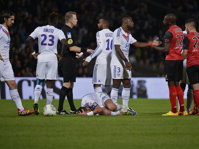 Lyon's French midfielder Maxime Gonalons lies on the ground as he is injured during the French L1 football match Olympique Lyonnais (OL) vs Guingamp (EAG) on November 2, 2013