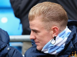 Joe Hart of Manchester City sits on the bench during the Barclays Premier League match between Manchester City and Norwich City at Etihad Stadium on November 2, 2013
