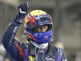 Red Bull's Mark Webber celebrates after securing pole position during qualifying for the Abu Dhabi Formula One Grand Prix on November 2, 2013