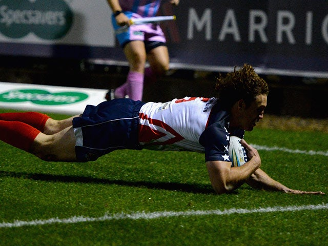 USA's Matthew Petersen scores a try against Cook Islands during their World Cup match on October 30, 2013