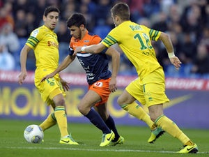 Montpellier's French midfielder Morgan Sanson advances with the ball past Nantes' French midfielders Lucas Deaux and Banel Nicolita during the French L1 football match between Montpellier and Nantes at the Mosson stadium in Montpellier, southe