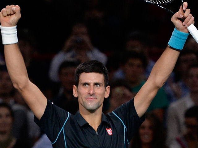 Novak Djokovic celebrates his win over Roger Federer during the semi finals of the Paris Masters on November 2, 2013