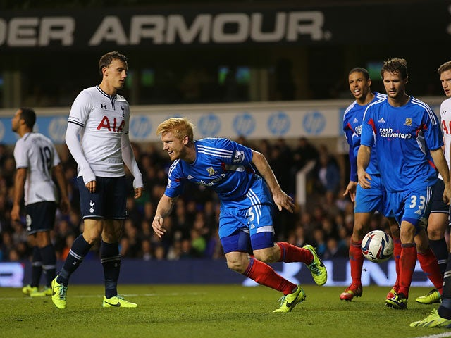 Hull's Paul McShane celebrates after scoring his team's second goal against Spurs during the Capital One Cup Fourth Round match on October 30, 2013