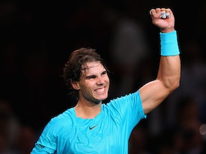 Rafael Nadal celebrates his win over Marcel Granollers during round two of the Paris Masters on October 30, 2013