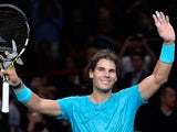 Rafael Nadal celebrates his win over Richard Gasquet during the quarter finals of the Paris Masters on November 1, 2013