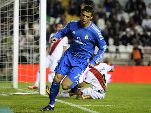 Real Madrid's Portuguese forward Cristiano Ronaldo celebrates after scoring during the Spanish league football match Rayo Vallecano vs Real Madrid at the Vallecas stadium in Madrid on November 2, 2013