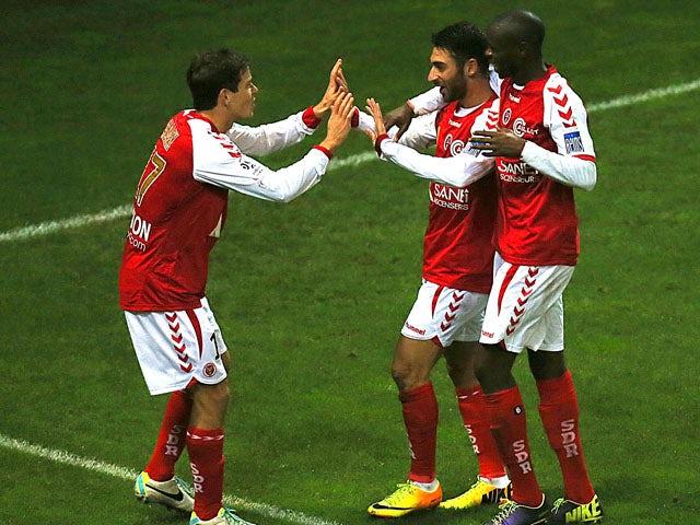 Reims' Eliran Atar celebrates after scoring a goal during the French L1 football match Reims vs Bastia on November 2, 2013