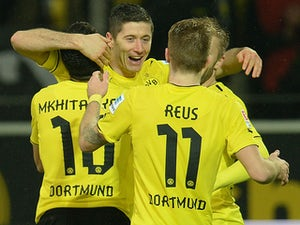 Dortmund's Robert Lewandowski celebrates with teammates after scoring his team's fourth goal against Stuttgart on November 1, 2013