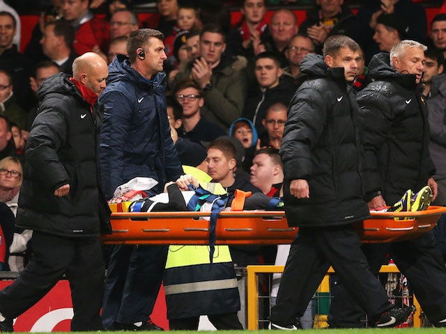 Robert Snodgrass of Norwich City leaves the field on a stretcher during the Capital One Cup fourth round match against Manchester United on October 29, 2013