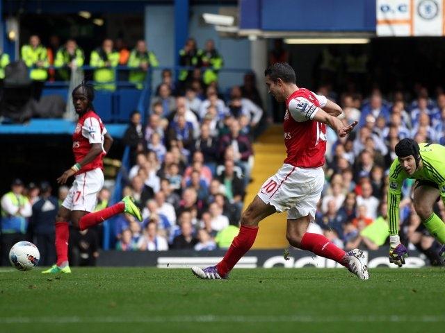 Robin van Persie celebrates scoring Arsenal's opening goal at Stamford Bridge on October 29, 2011.