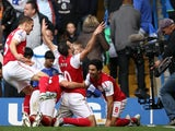Robin van Persie and his Arsenal teammates celebrate the winning goal against Chelsea in October 29, 2011.
