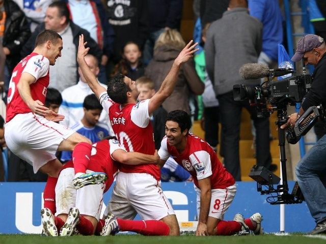 Robin van Persie and his Arsenal teammates celebrate the winning goal against Chelsea in October 29, 2011.