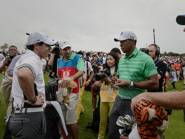 Rory McIlroy and Tiger Woods during their exhibition match at Mission Hills Golf Club in China on October 28, 2013