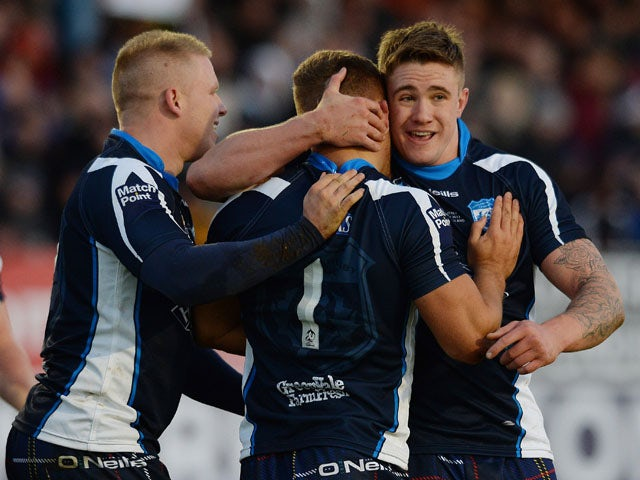 Matthew Russell of Scotland celebrates his try during the Scotland v Italy Rugby League World Cup Group C match at Derwent Park on November 3, 2013