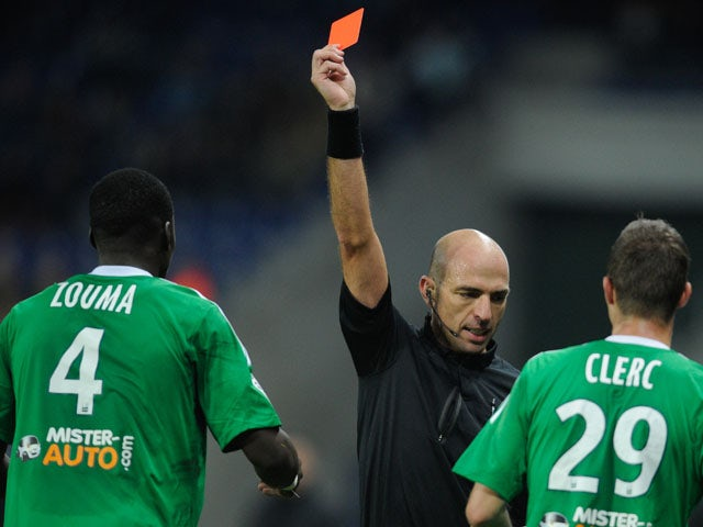 French referee Bartolomeu Varela gives a red card to Saint Etienne's French defender Kurt Zouma during the French L1 football match Sochaux (FCSM) against Saint Etienne (ASSE) on November 2, 2013