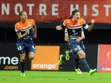 Montpellier's French defender Benjamin Stambouli celebrates with teammates after scoring a goal during a French L1 football match against Valenciennes on November 9, 2013