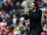 Sunderland manager Gus Poyet gestures on the touchline during the match against Man City on November 10, 2013