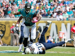 Marcedes Lewis #89 of the Jacksonville Jaguars runs for yardage during the game against the San Diego Chargers at EverBank Field on October 20, 2013