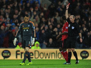 Swansea City goalkeeper Michel Vorm is sent off by referee Mike Dean during the Barclays Premier League match between Cardiff City and Swansea at Cardiff City Stadium on November 3, 2013
